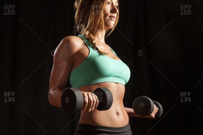 Woman lifting hand weights