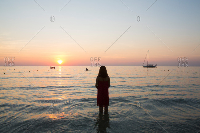 Little girl standing in the sea in Bali