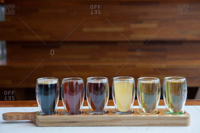 Samples of beer on a wooden board