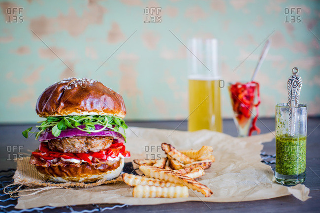 Hamburger, French fries and a beer