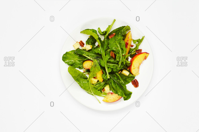 Arugula salad with peaches and pecans