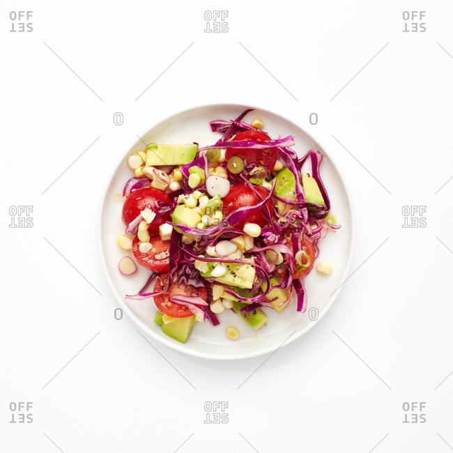 Red cabbage, corn, tomato and avocado salad