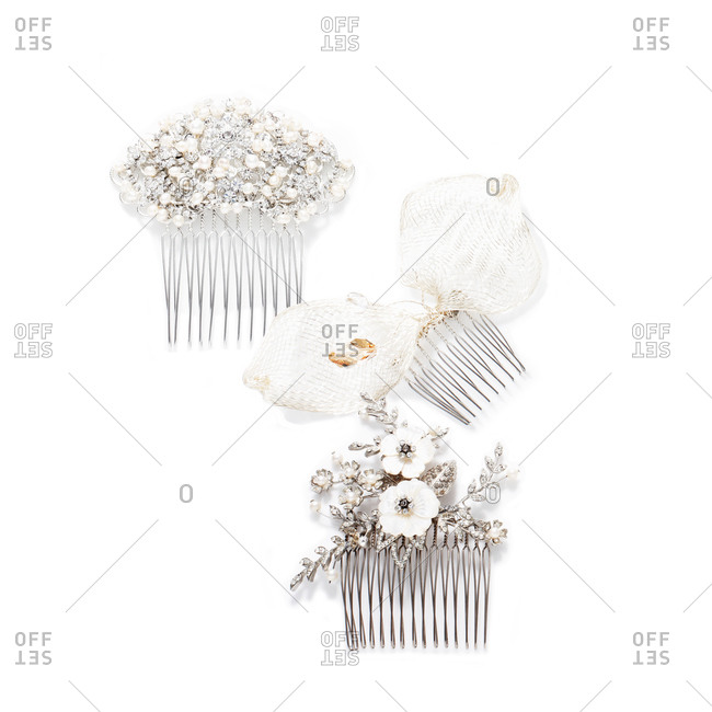 Jewel-covered hair combs on white background
