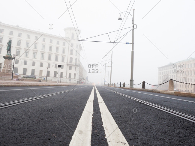 Road and trolley lines on a foggy day in Gothenburg, Sweden