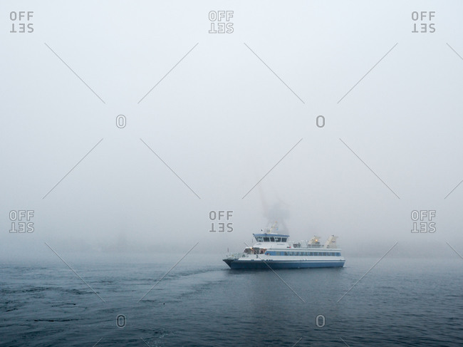 Ferry boat on foggy waters in Gothenburg, Sweden