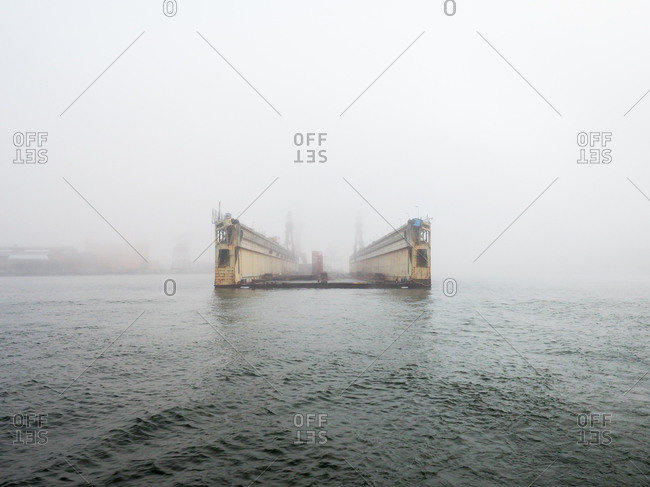 Commercial dock in foggy waters in Gothenburg, Sweden