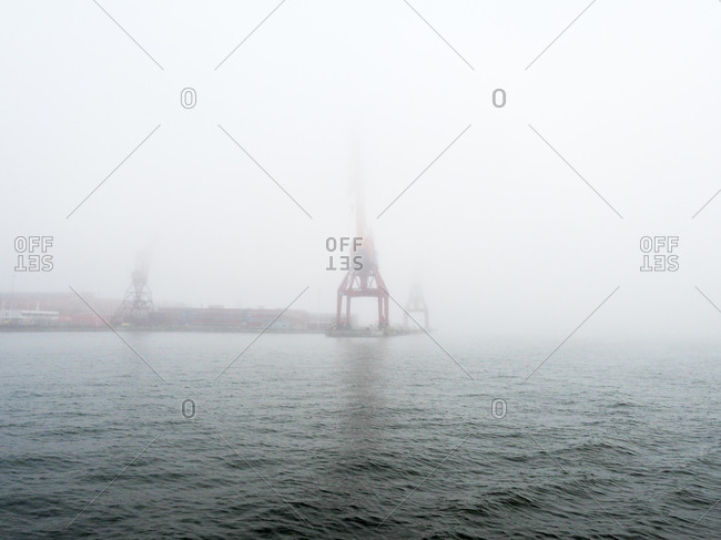Crane over foggy waters in Gothenburg, Sweden