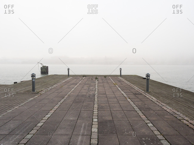 Cement waterfront pier on a foggy day in Gothenburg, Sweden