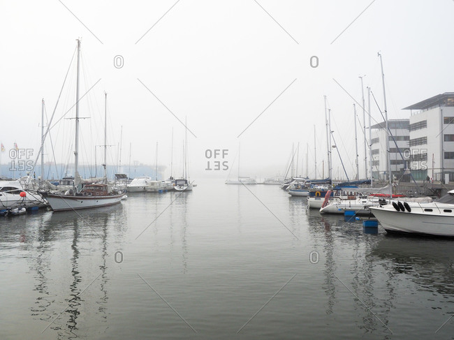 Boats in a marina on a foggy day in Gothenburg, Sweden