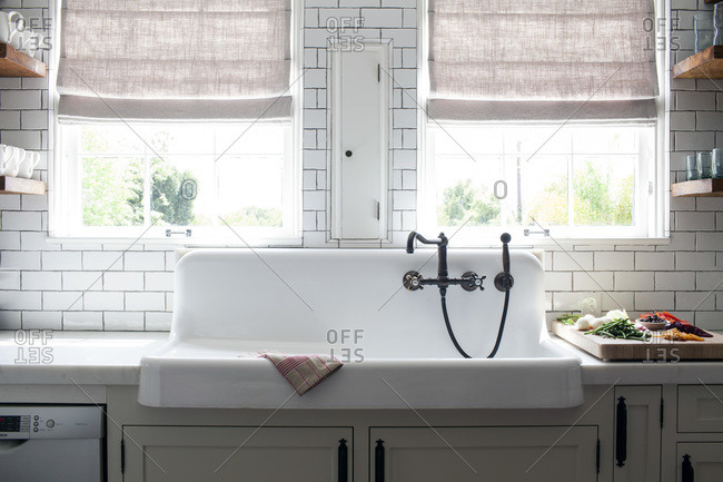 Rustic White Porcelain A Kitchen Sink With Rubbed Oil Bronze Faucet And Subway Tile Backsplash Under Windows Stock Photo Offset