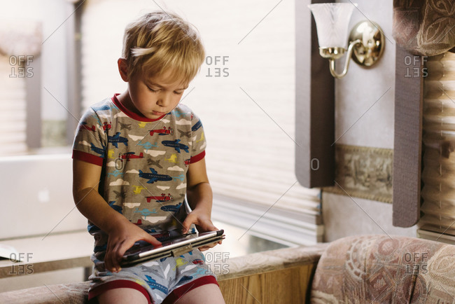 Boy looking at a tablet in RV