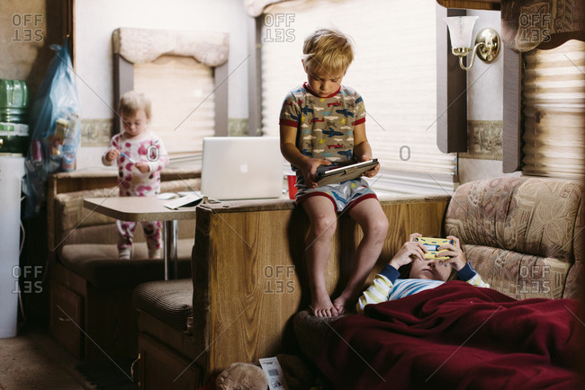 Kids looking at devices in an RV