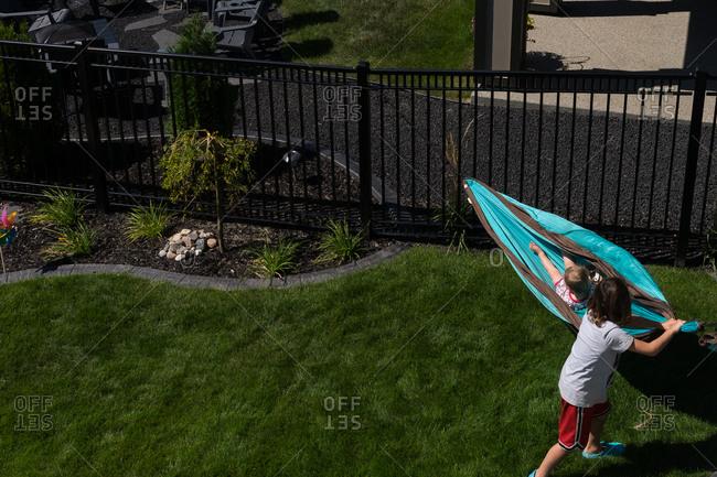 Boy playing in a backyard hammock