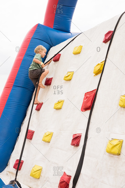Boy claiming an inflatable climbing wall