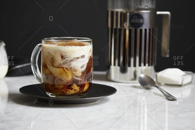 Milk swirling in a cup of coffee