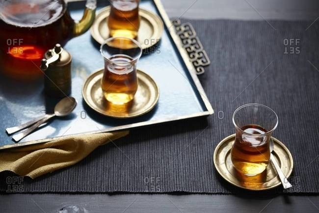 Cup of tea on placemat with tea serving tray