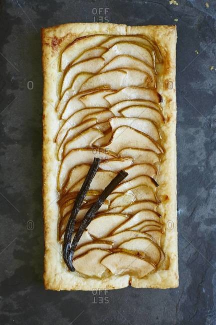 Overhead view of pear tart with vanilla bean