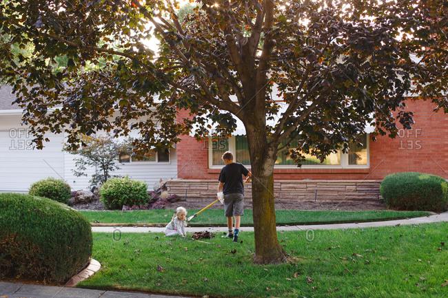 Boy and girl doing yard work