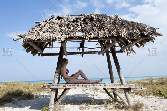 Woman in cabana at the beach in Cuba