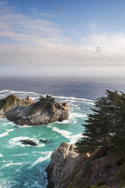 Cliffs and island overlooking vast sea