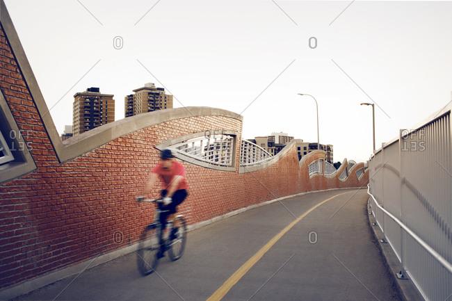 Man riding on an urban bike path
