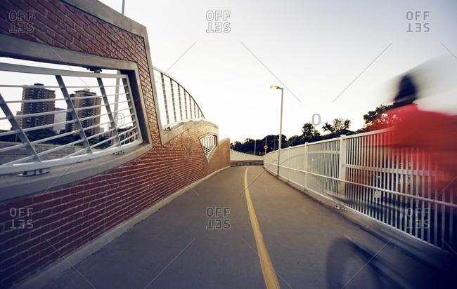 Man riding bike on an urban bike path