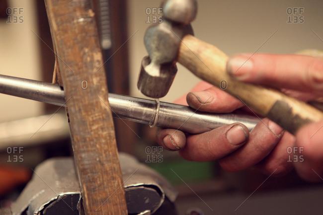 Craftsman reshaping bent ring