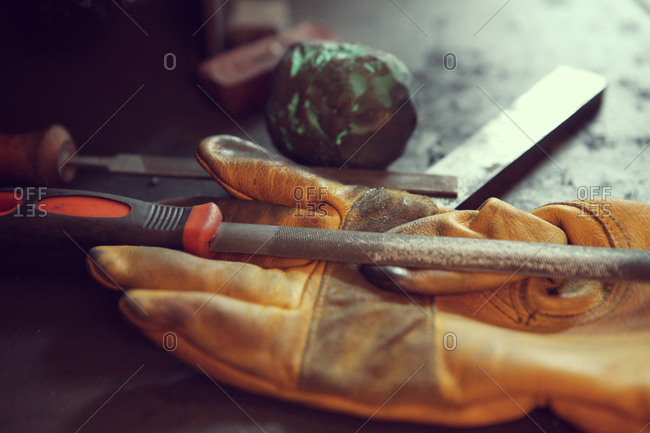 Old tools and work gloves