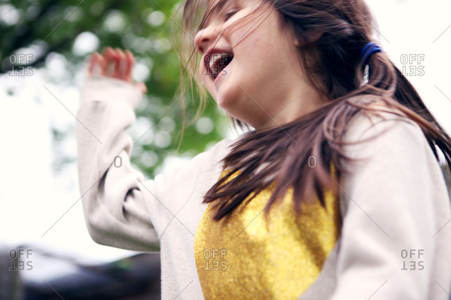 Happy girl dancing around outside