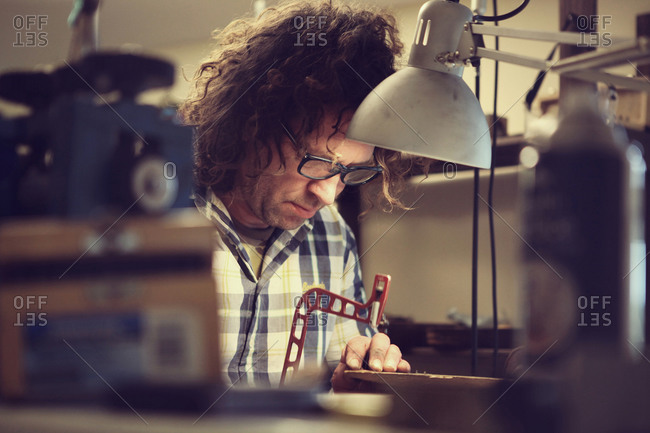 Craftsman designing a metal coin