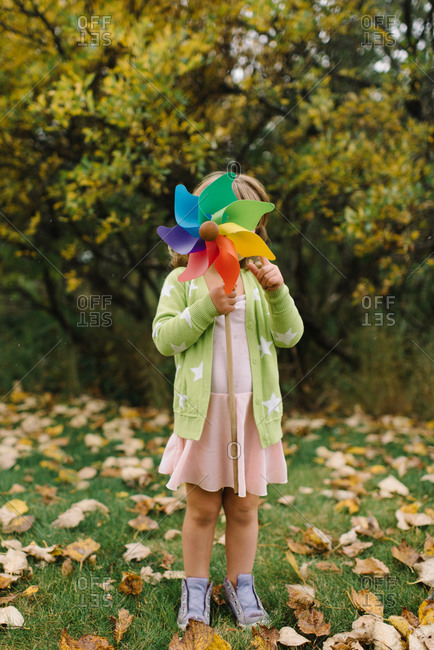 Young girl holding pinwheel in front of her face