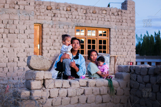 Shey, Ladakh, India - August 27, 2010: Family in front of their home