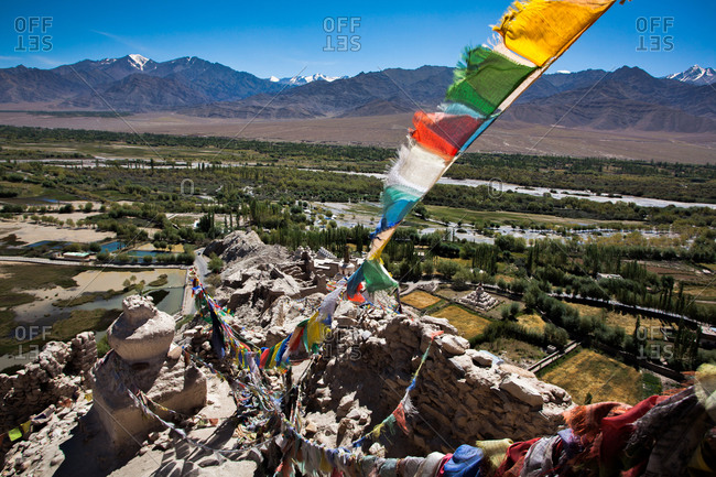 Prayer flags and view over Himalayan desert region
