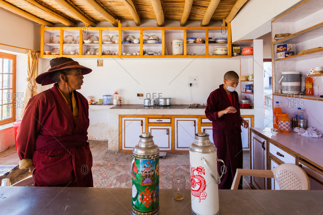 Shey, Ladakh, India - August 30, 2010: Buddhist nuns in Druk Gompa kitchen