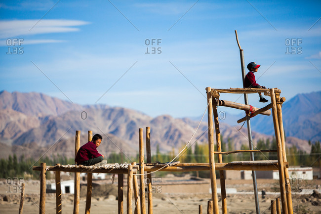 Shey, Ladakh, India - August 30, 2010: Boys on a wooden platform