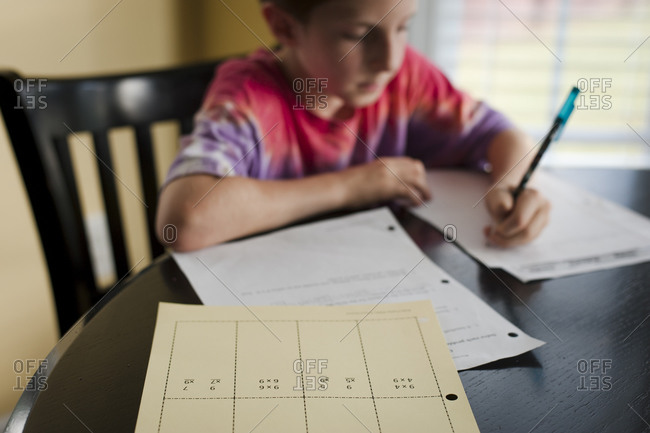 Boy concentrating on homework at table