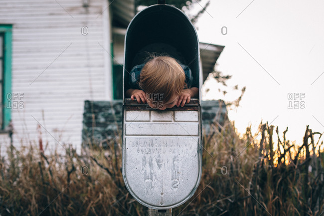 Baby inside of a mailbox