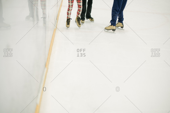 Feet of people in an ice skating rink