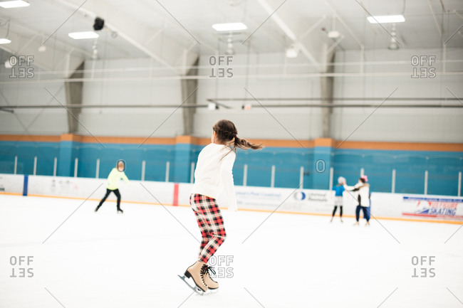 Little girl at an ice skating rink