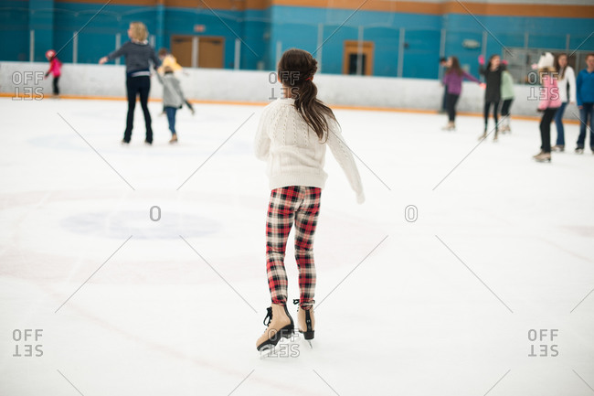 Little girl skating at an ice rink