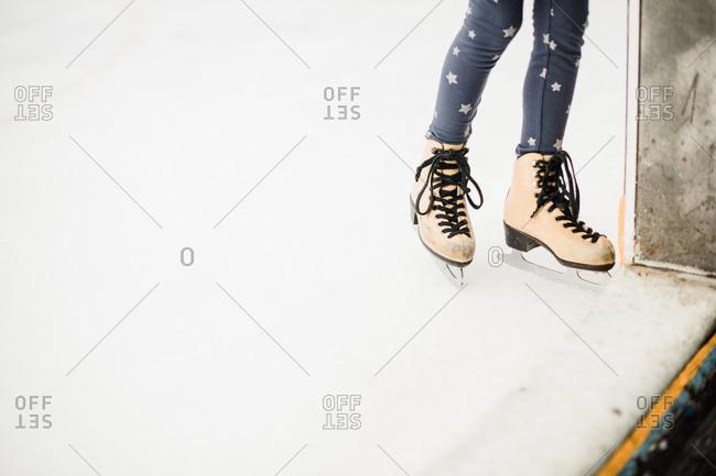 Feet of a little girl in ice skates