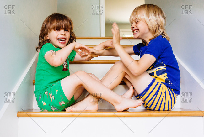 Two little boys playing on stairs