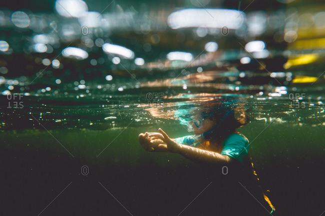 Underwater image of boy snorkeling in a lake