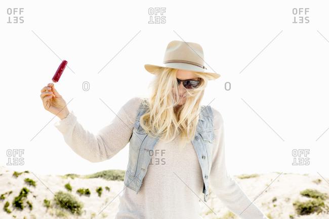 Blonde woman enjoying a popsicle