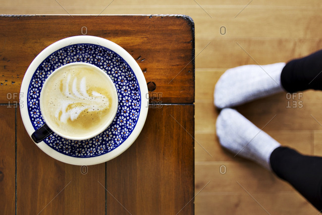 Coffee drink and feet in socks