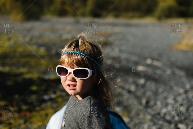Portrait of a little girl on a gravel path