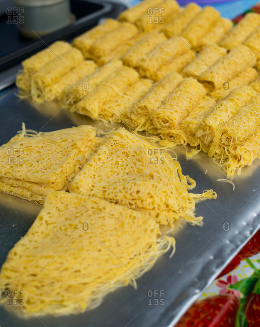 Roti jala, or net pancakes, for sale at a Malaysian food market