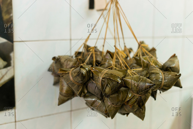 Nyonya dumpling bundles hanging for sale at street market