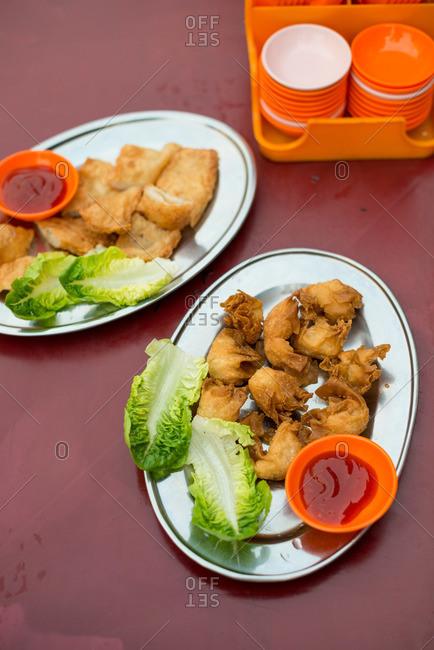 Plates of fried dumplings with sauce
