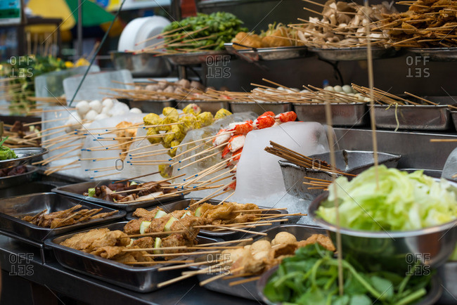 Various skewered foods at a Malaysian street market